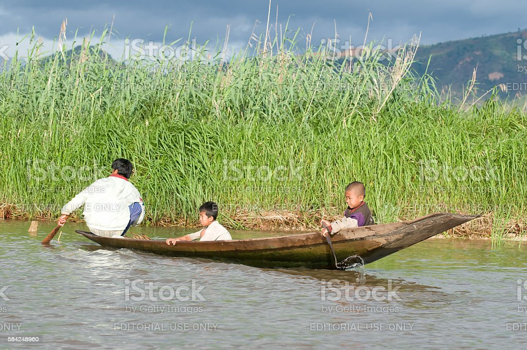 Children on boat in Inle lake, Myanmar stock photo