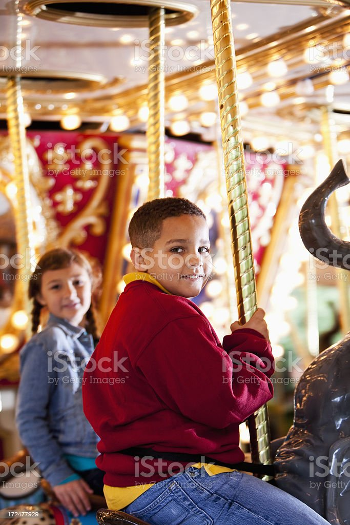 Children on carousel royalty-free stock photo