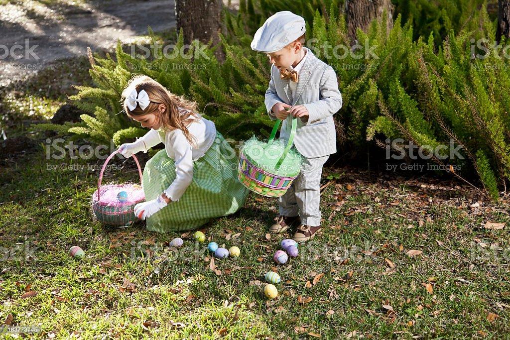 Children on easter egg hunt stock photo