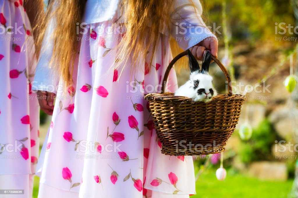 Children on Easter egg hunt with bunny stock photo