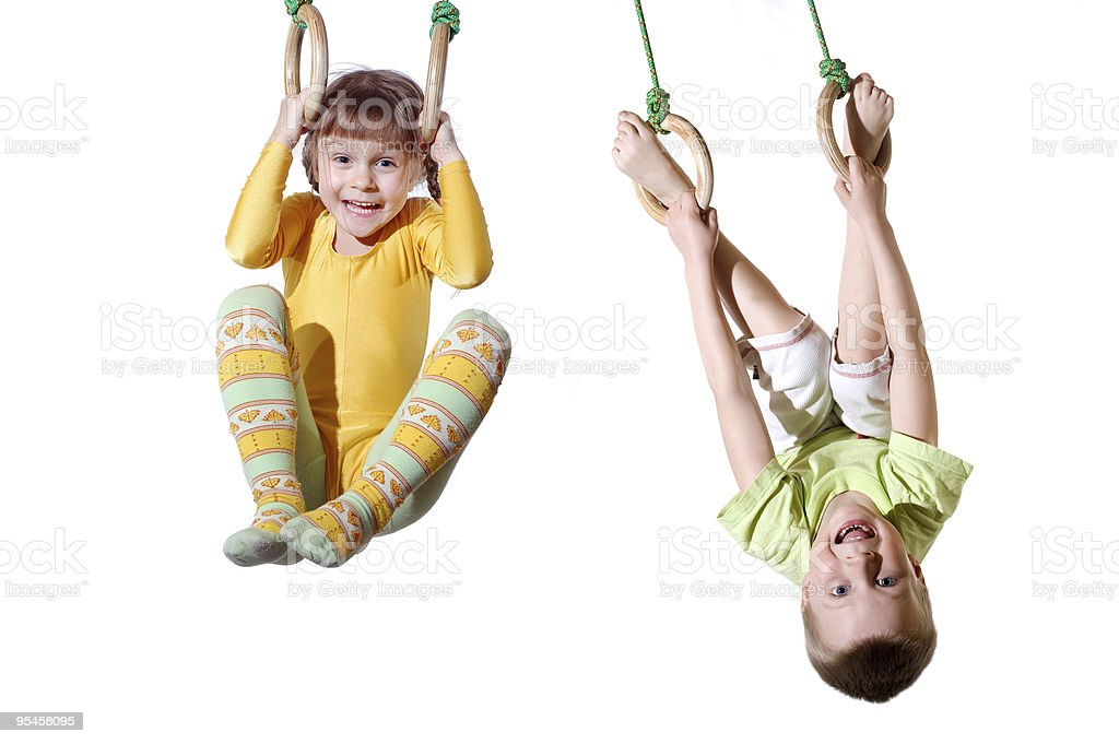 children on gym rings stock photo