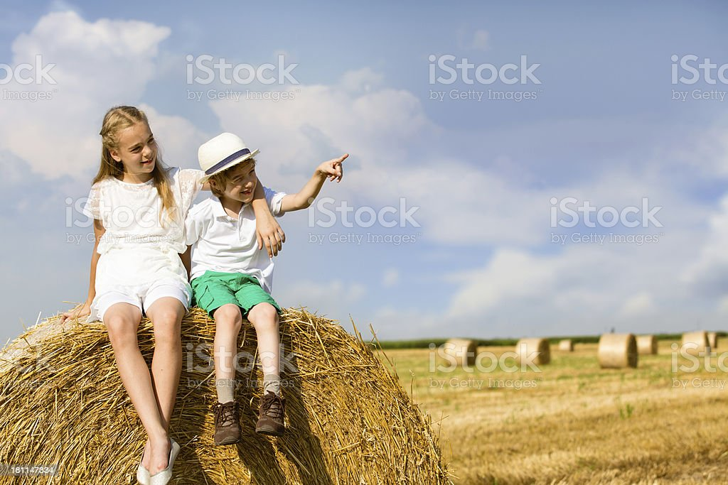 Children on haystack royalty-free stock photo