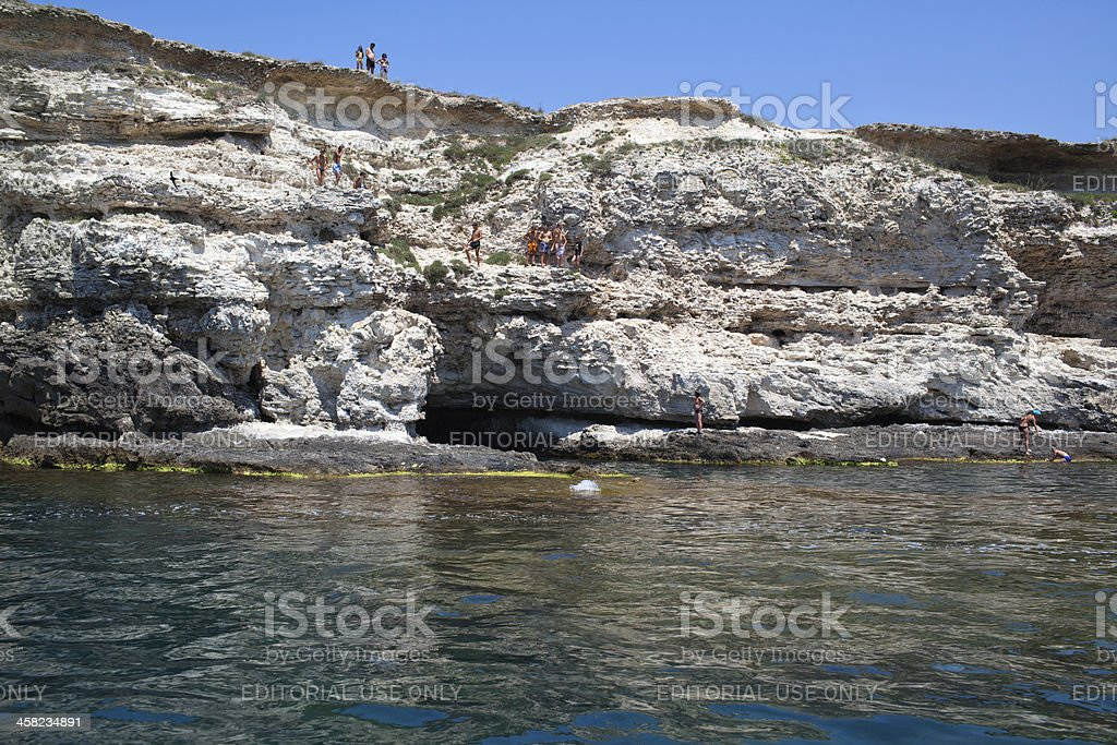 Children on rocky cliffs stock photo