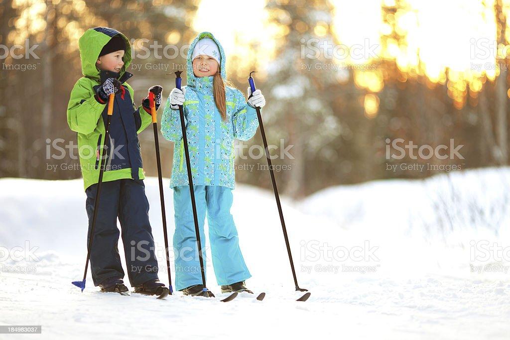 Children on ski stock photo
