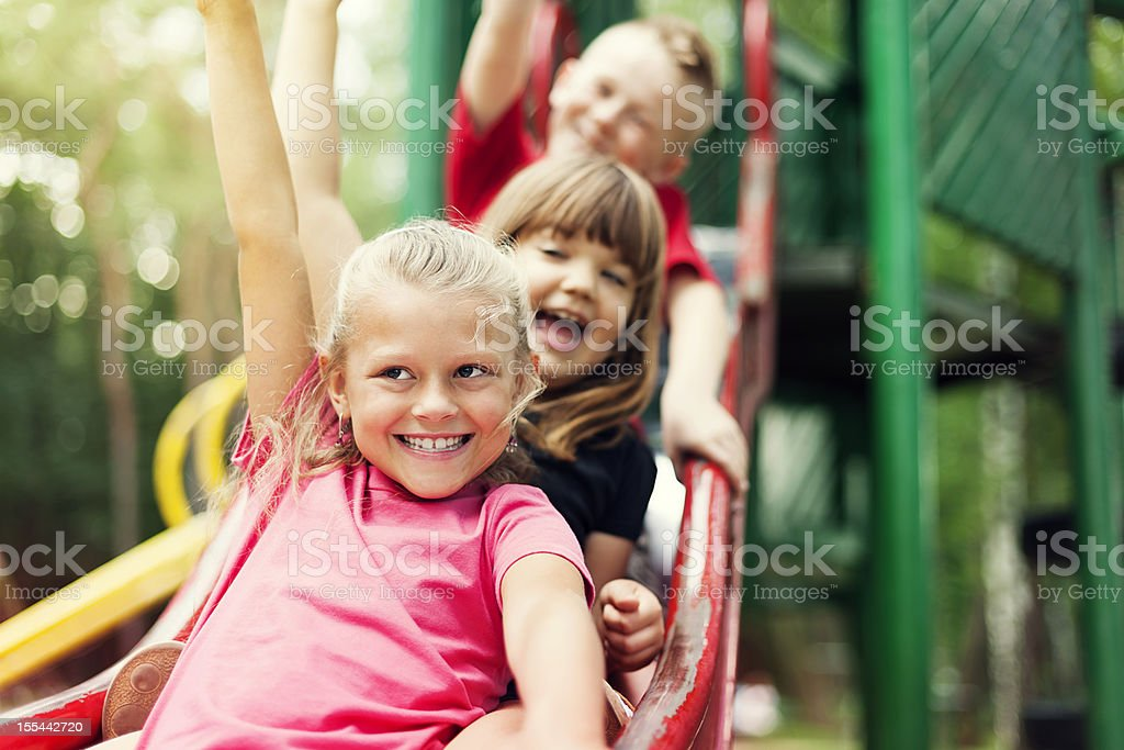 Children on slide stock photo