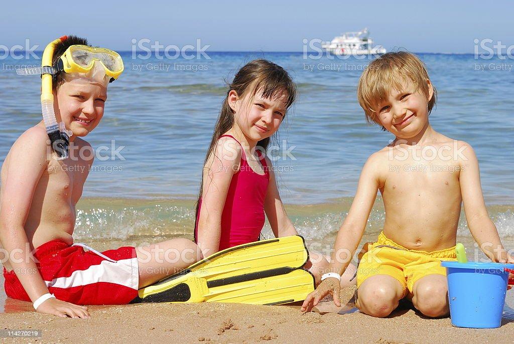 Children on the beach royalty-free stock photo
