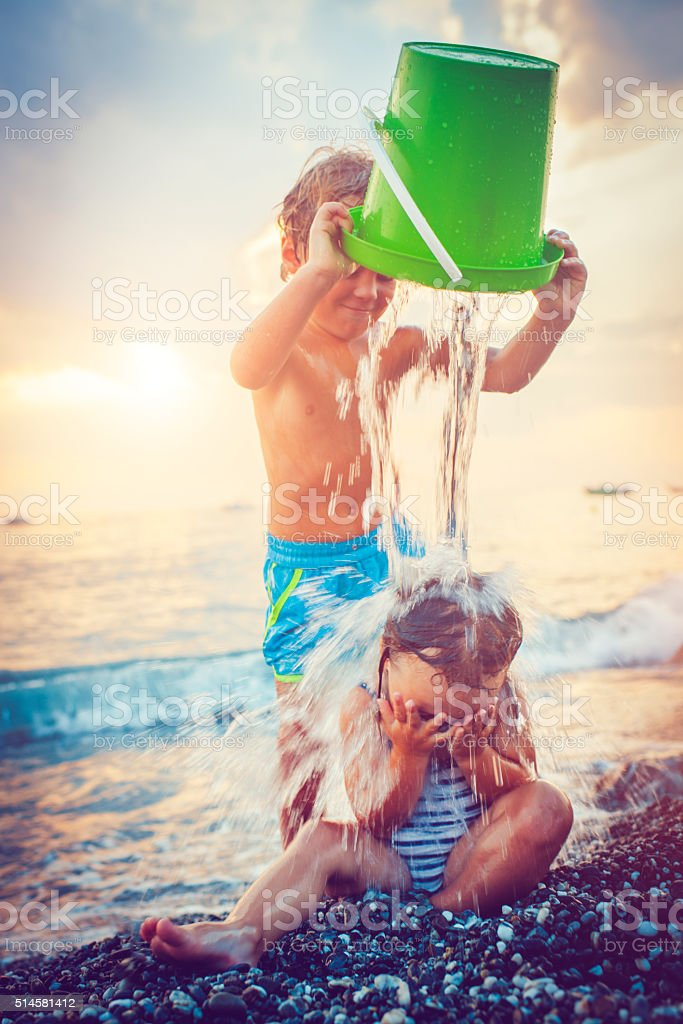 Children on the beach stock photo