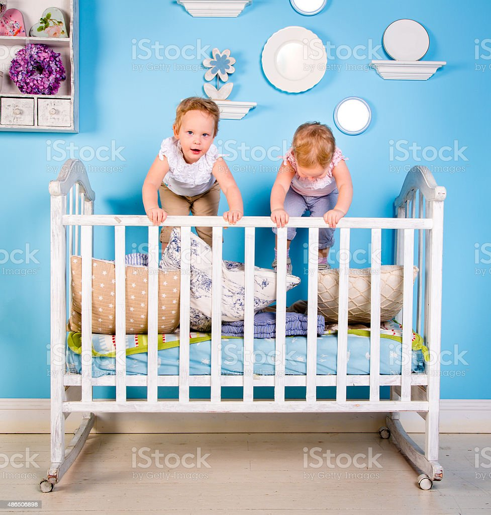 Children on the bed stock photo