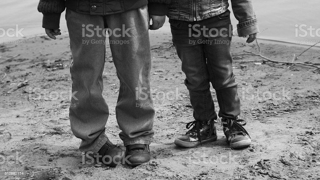 Children on the shore stock photo