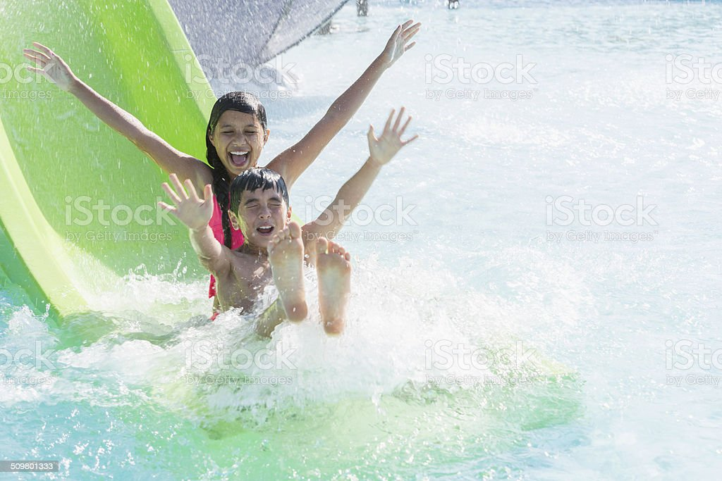 Children on water slide stock photo