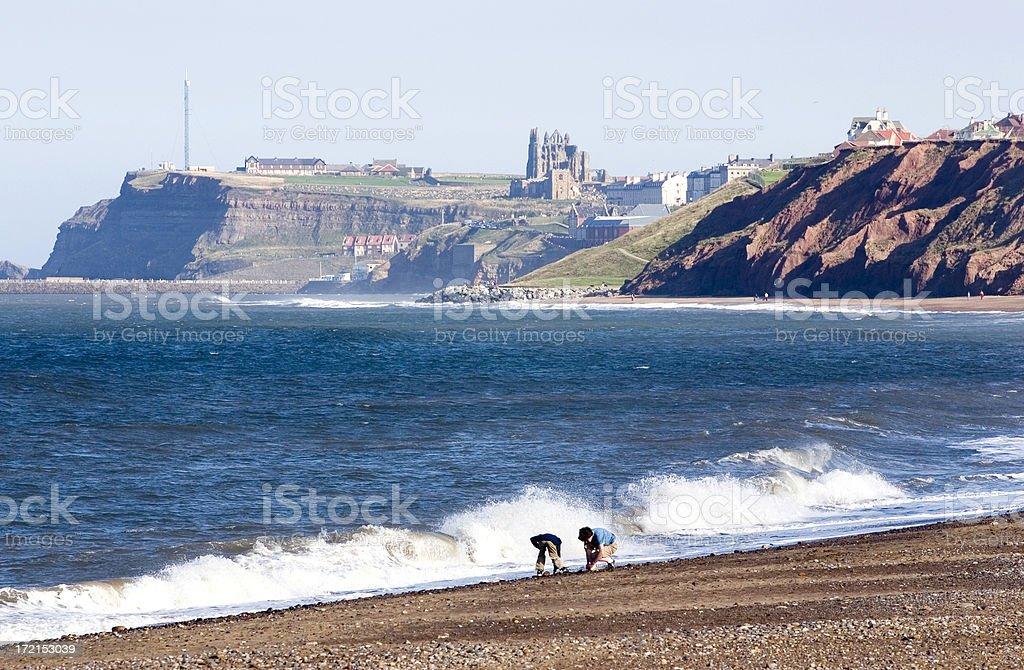 children on Whitby beach, Yorkshire, England royalty-free stock photo