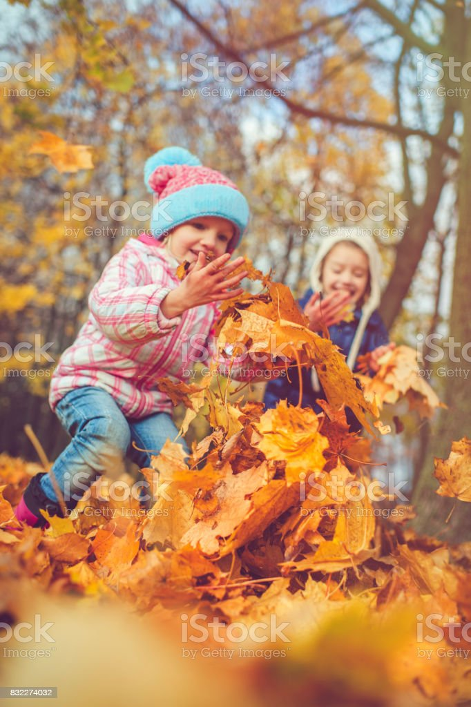 Children outdoors in autumn stock photo