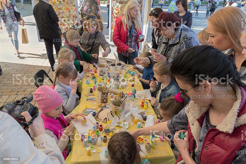 Children painted Easter eggs on Sophia Square. Kiev, Ukraine stock photo