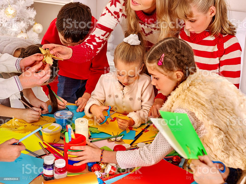 Children painting and cut sissors paper at art school stock photo