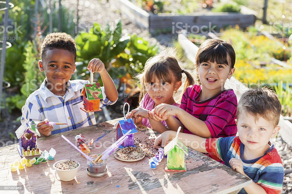 Children painting bird houses stock photo