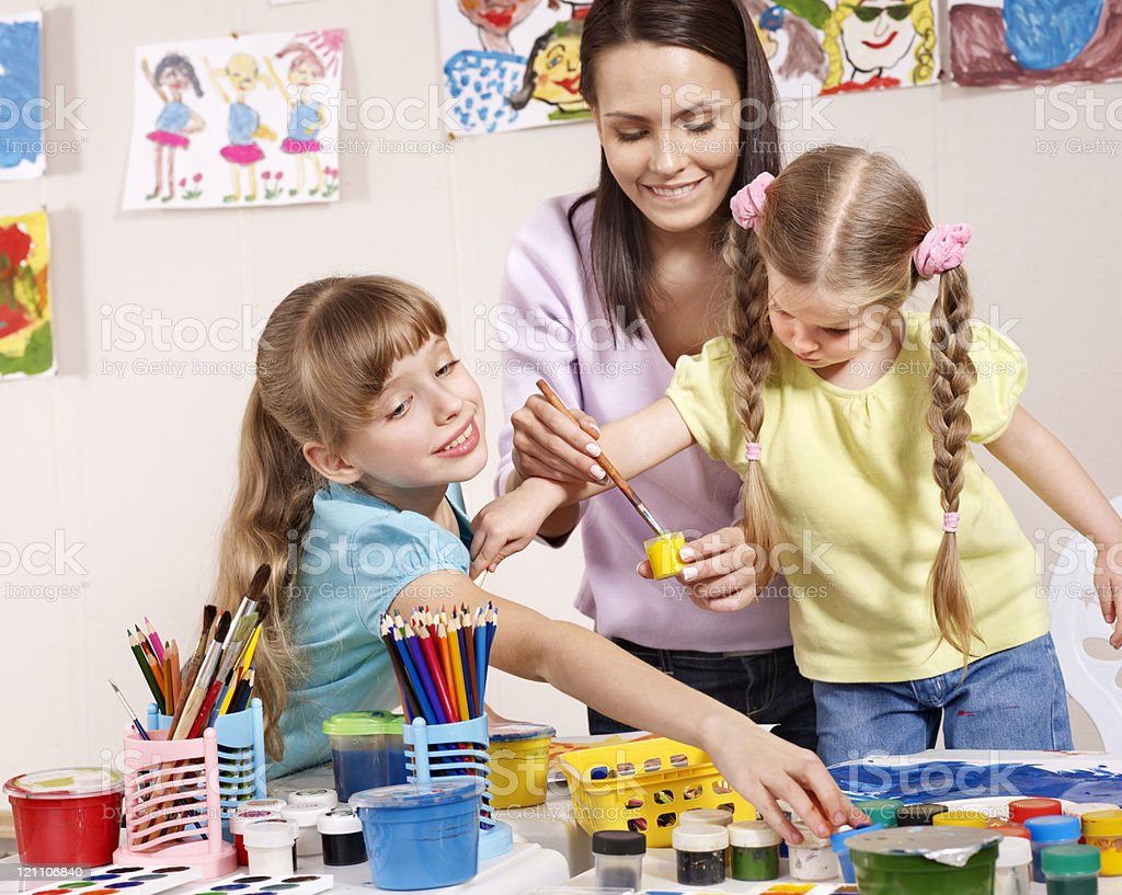 Children painting in preschool. royalty-free stock photo