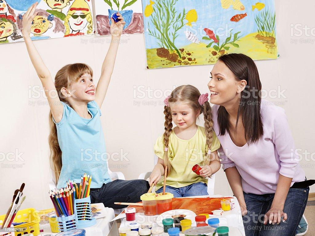 Children painting in preschool. royalty-free stock photo