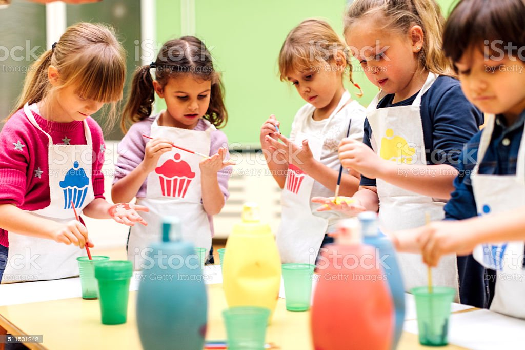 Children Painting Their Hands With Watercolors. stock photo