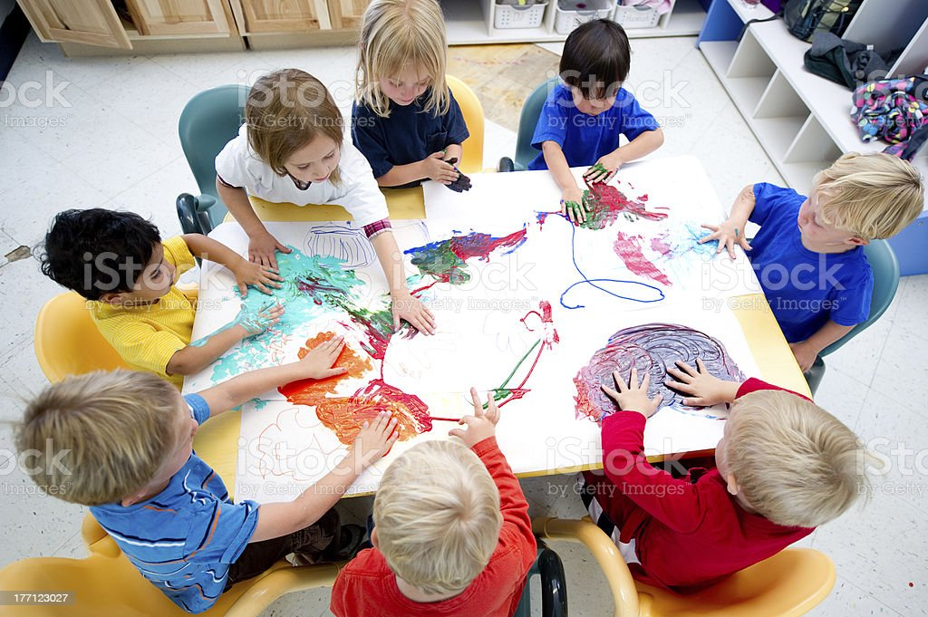 Children painting together stock photo