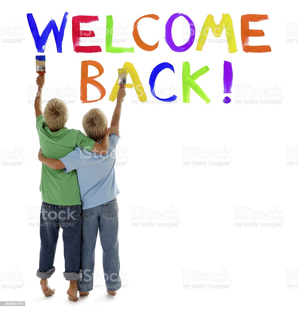 Children Painting Welcome Back on White stock photo