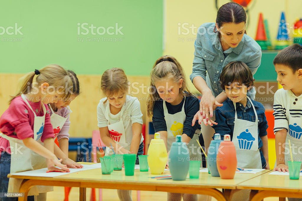 Children Painting With Watercolors stock photo