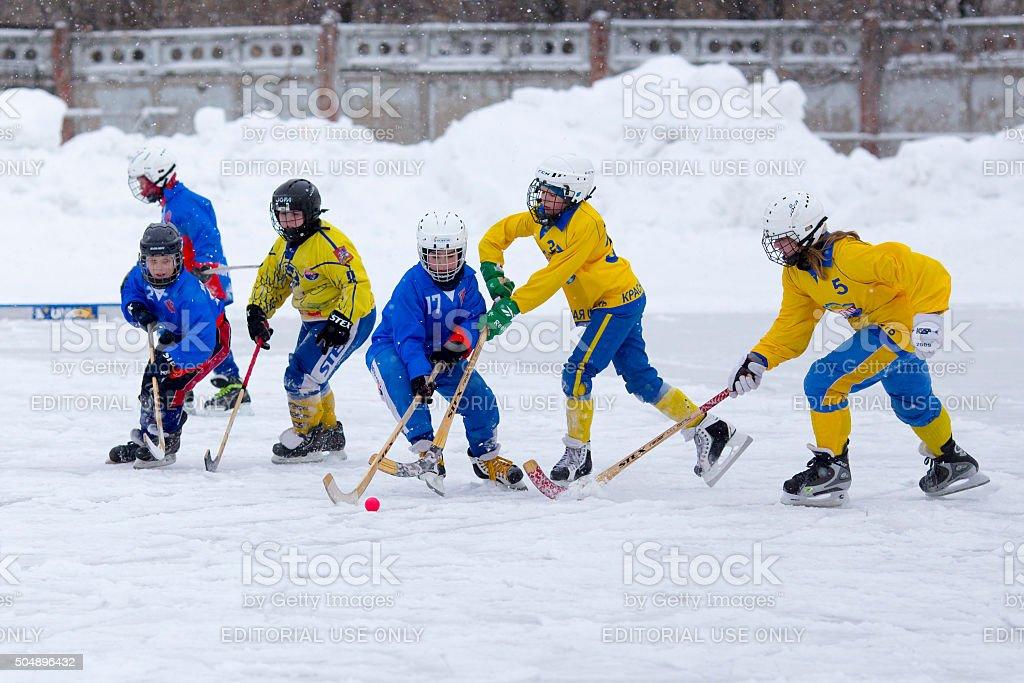 Children play bandy stock photo