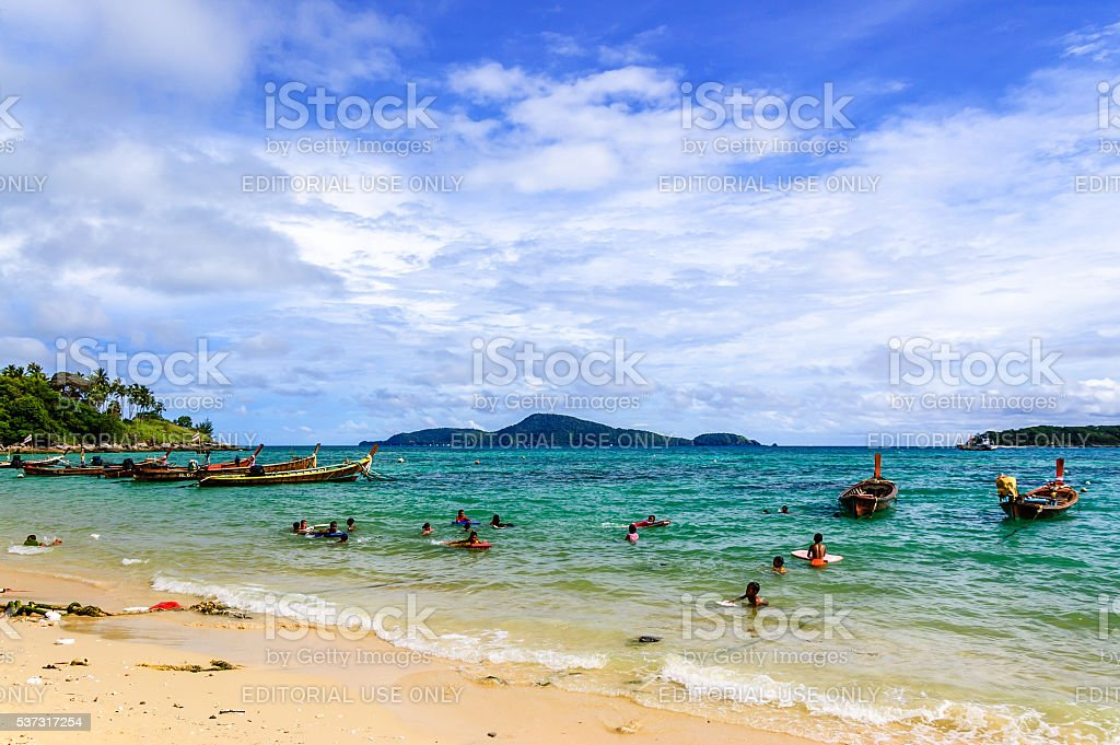 Children play in sea off beach, Phuket, Thailand stock photo