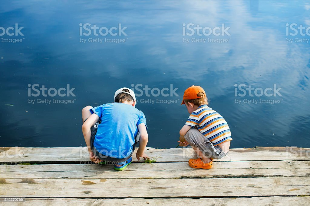 children play in the water without adult supervision stock photo