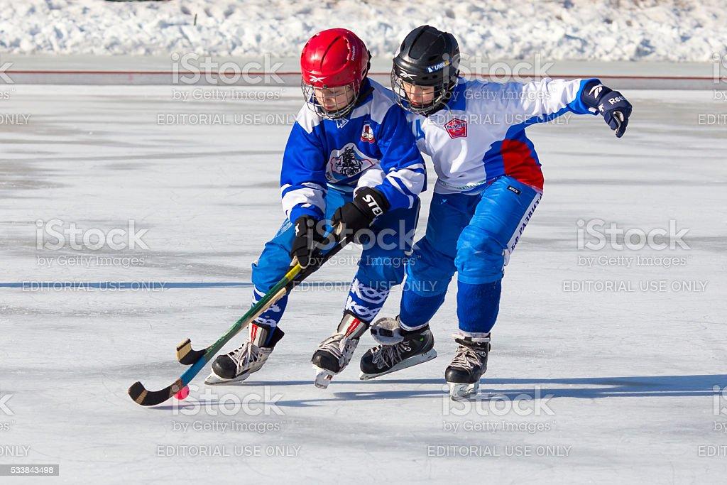 Children play on ice stock photo