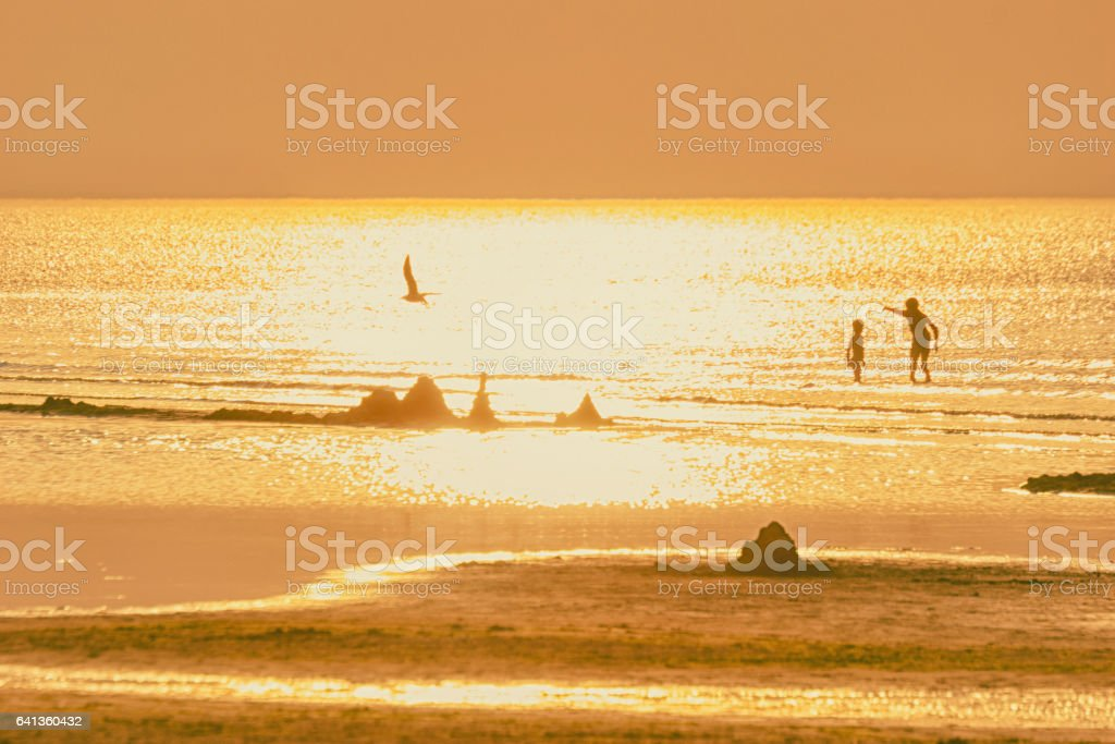 Children play on the Baltic sea stock photo