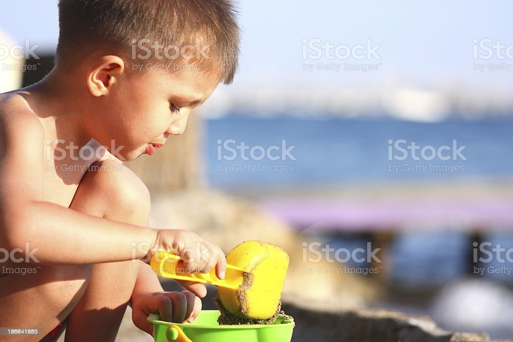 Children play on the beach royalty-free stock photo