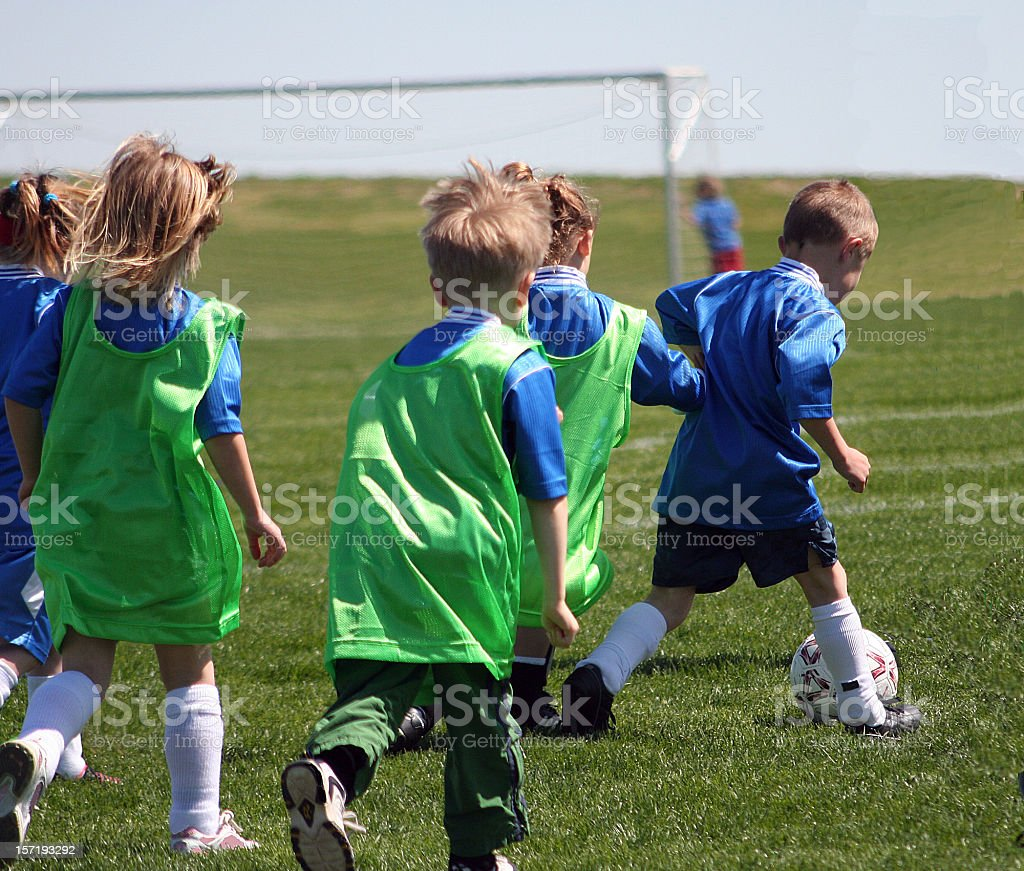 Children Play Soccer as Blue Has the Ball royalty-free stock photo