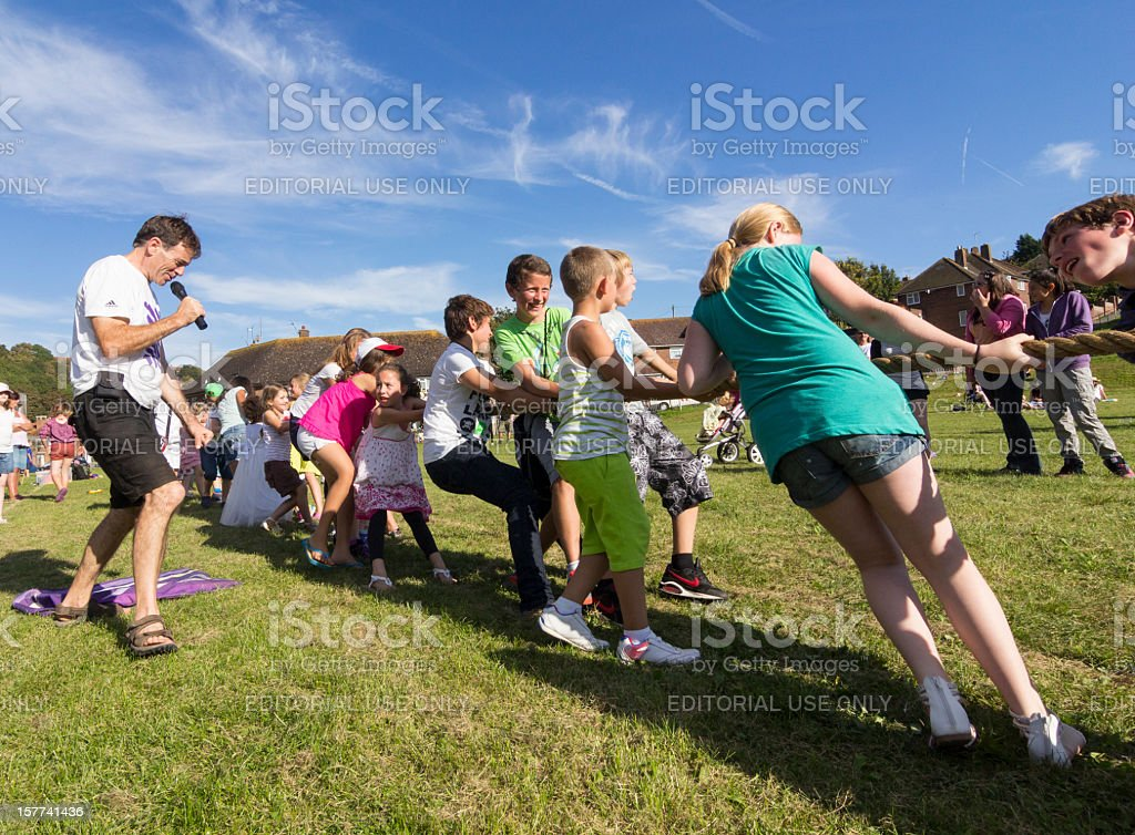 Children play tug-of-war at a local English festival stock photo