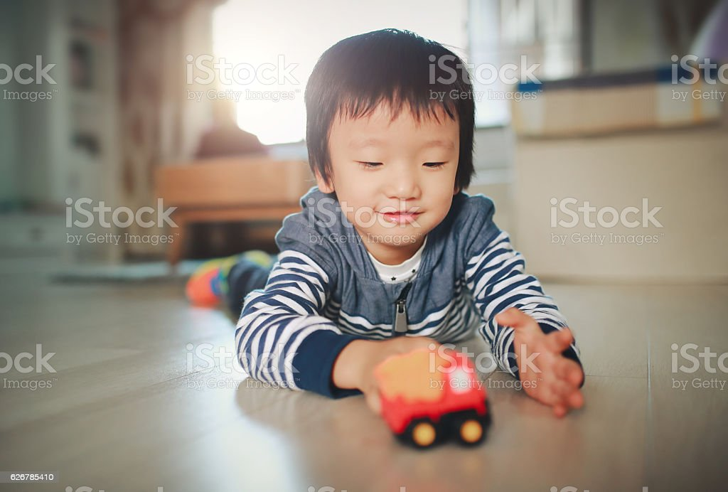 Children play with toy cars stock photo
