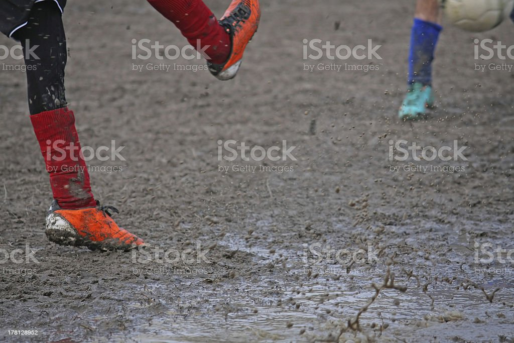 children players during a football match stock photo