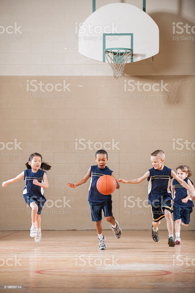 Children Playing a Basketball Game stock photo