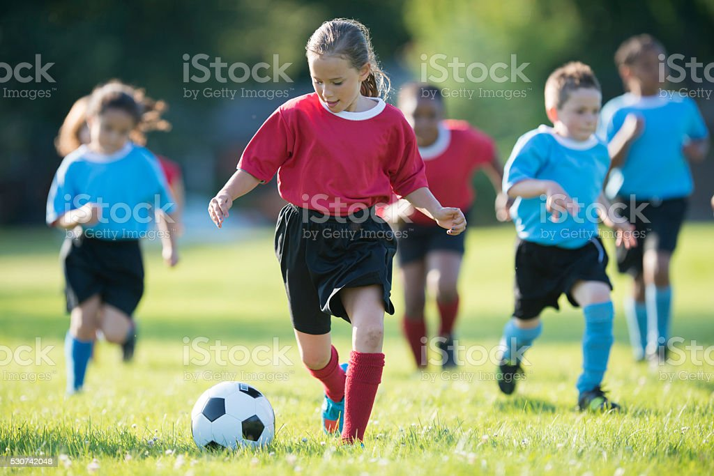Children Playing a Soccer Game stock photo