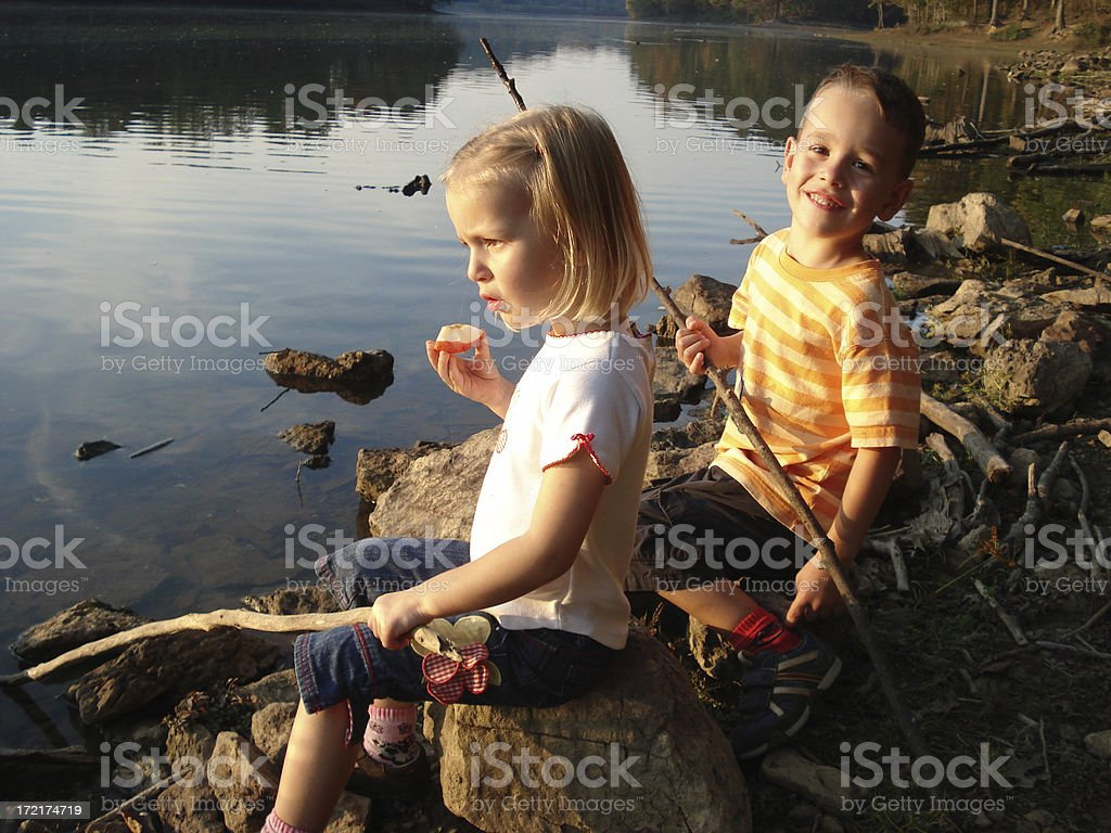 Children playing and fishing at lake royalty-free stock photo