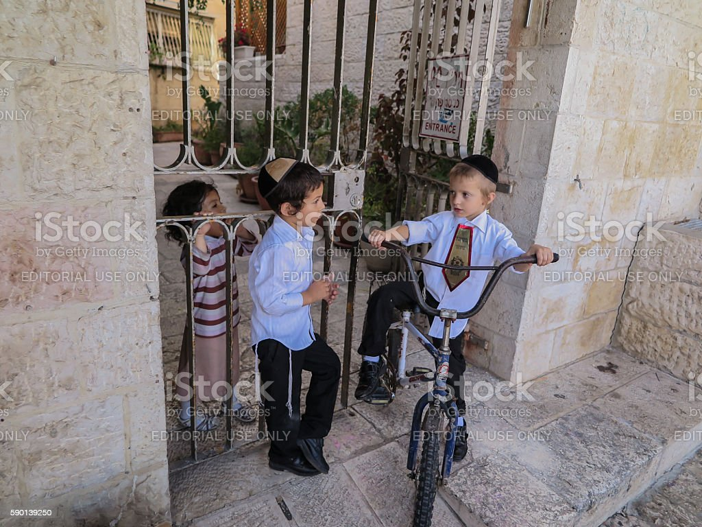 Children playing and talking at the entrance to the property stock photo