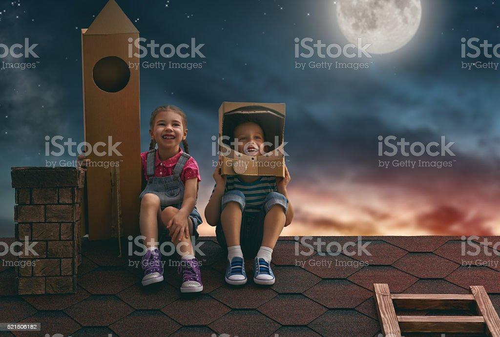children playing astronauts stock photo