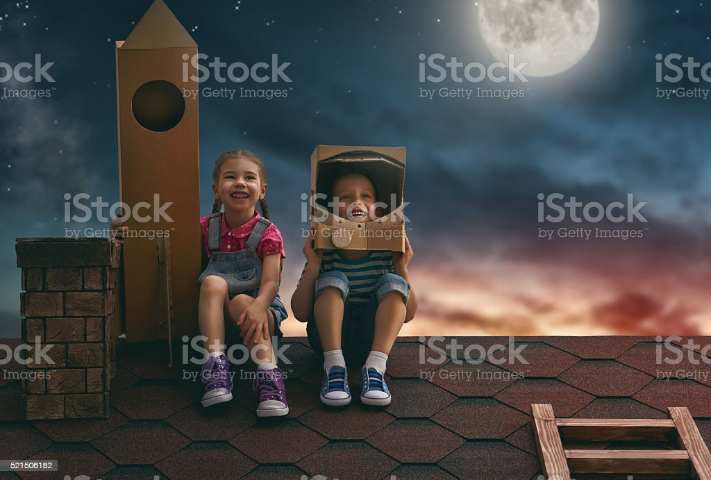 children playing astronauts stock photo