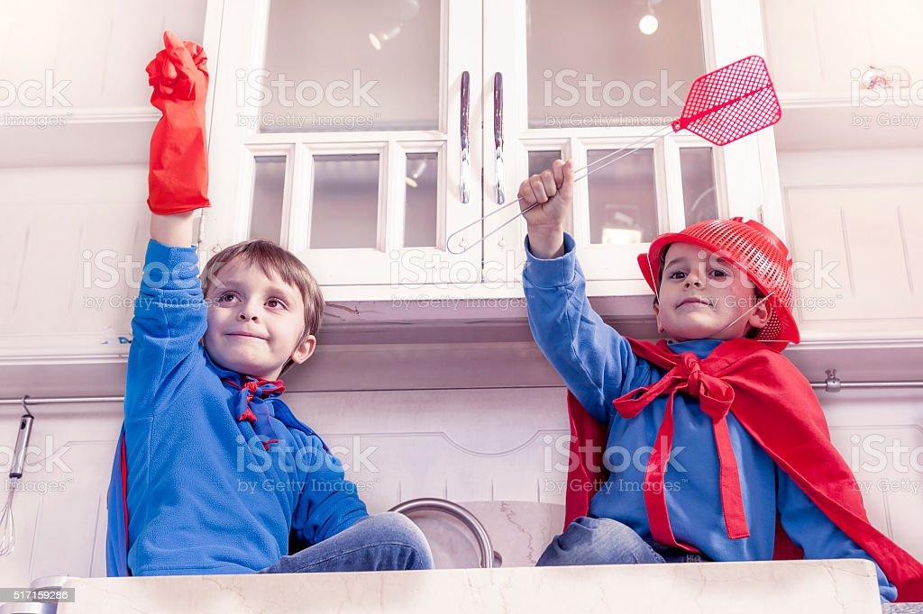 children playing at being wonderful hero stock photo
