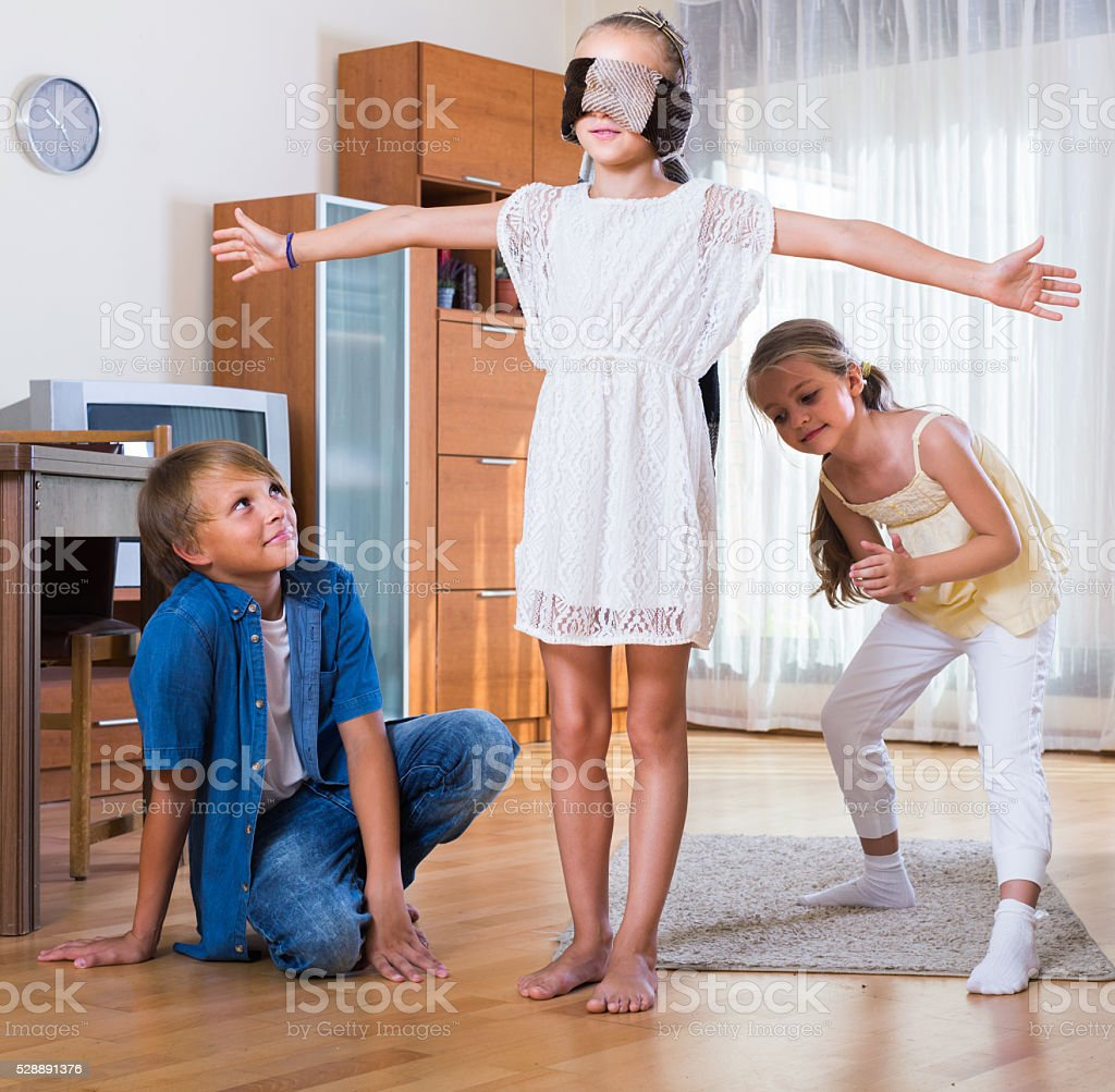 children playing at Blind man bluff indoors stock photo