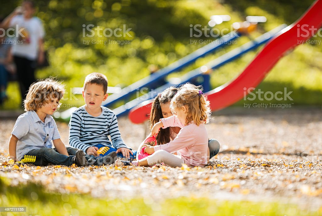 Children playing at the playground. stock photo