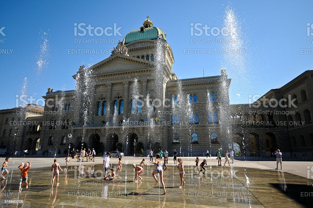 Children playing at the Swiss parliament Building stock photo