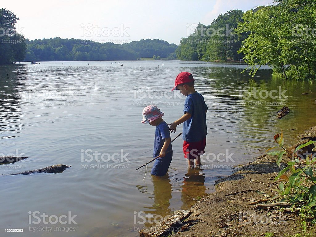 Children playing at the water royalty-free stock photo