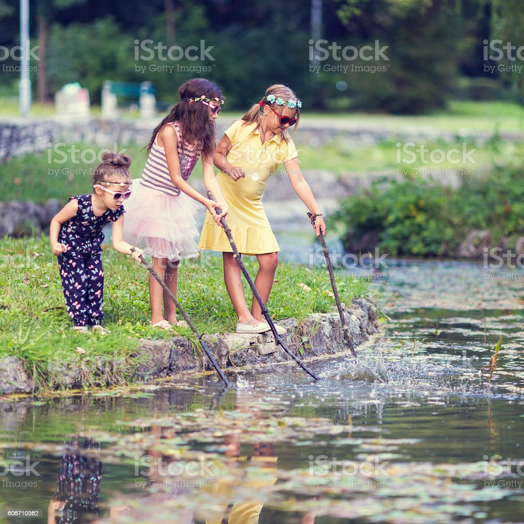 Children playing at the water stock photo