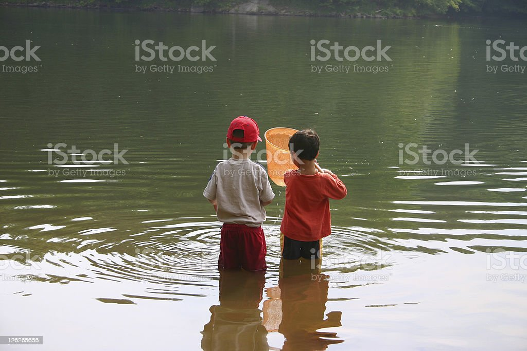 Children playing at the water/like, childhood memories royalty-free stock photo