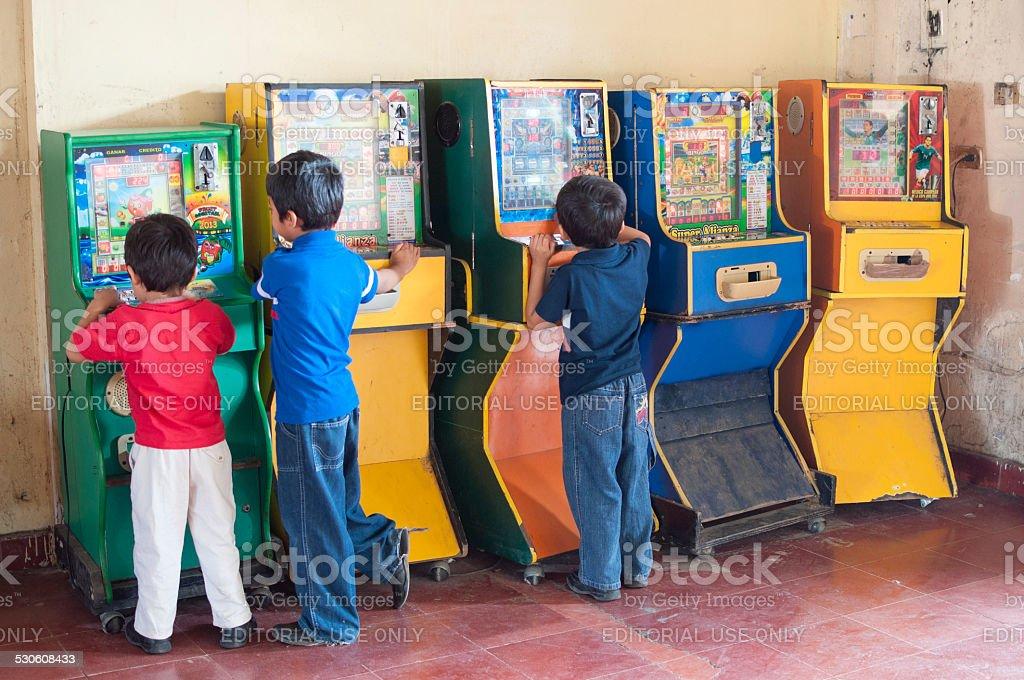 Children playing bingo arcade games stock photo