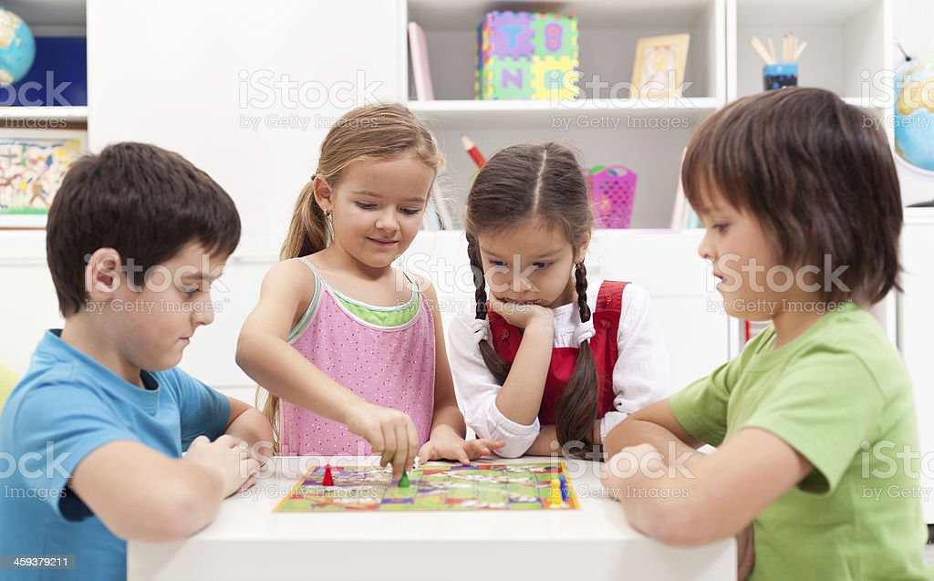 Children playing board game stock photo